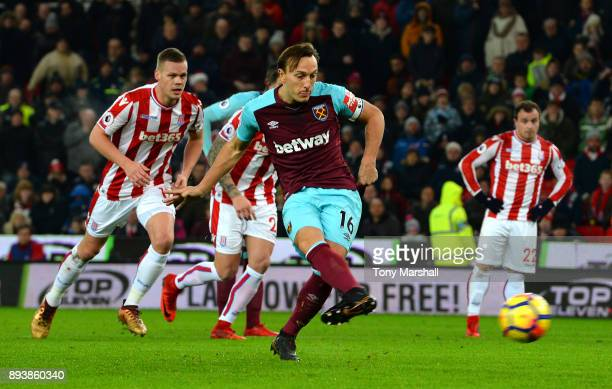 Mark Noble of West Ham United scores his sides first goal from the penalty spot during the Premier League match between Stoke City and West Ham...