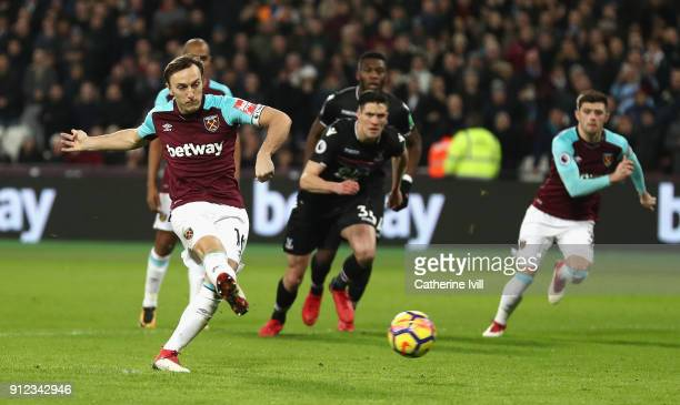 Mark Noble of West Ham United scores his sides first goal from the penalty spot during the Premier League match between West Ham United and Crystal...