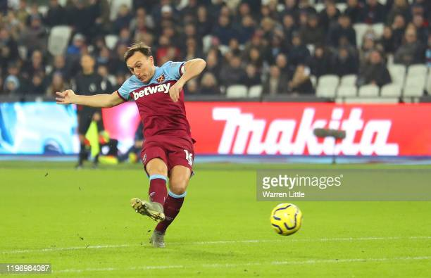 Mark Noble of West Ham United scores his team's first goal during the Premier League match between West Ham United and AFC Bournemouth at London...