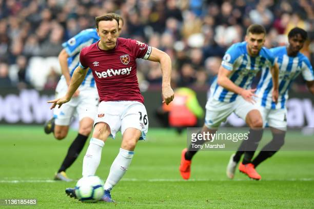 Mark Noble of West Ham United scores his team's first goal from the penalty spot during the Premier League match between West Ham United and...