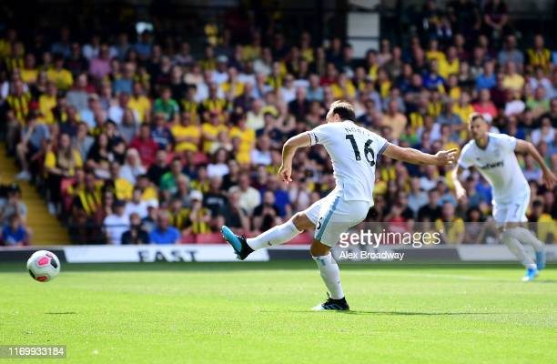 Mark Noble of West Ham United scores his team's first goal from the penalty spot during the Premier League match between Watford FC and West Ham...