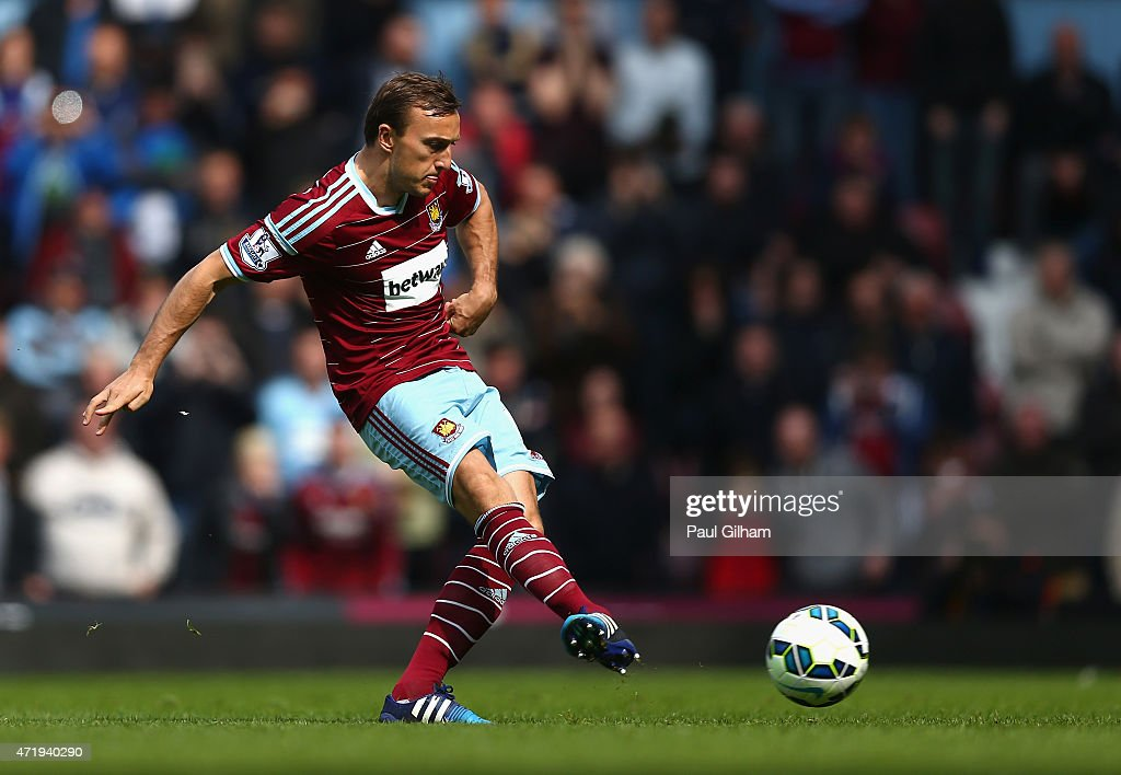 Mark Noble of West Ham United scores his team's first goal from the penalty spot during the Barclays Premier League match between West Ham United and Burnley at the Boleyn Ground on May 2, 2015 in London, England.