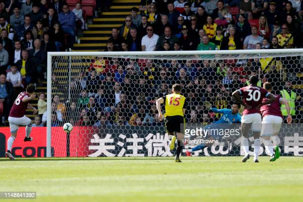 Mark Noble of West Ham United scores his team's fourth goal during the Premier League match between Watford FC and West Ham United at Vicarage Road...