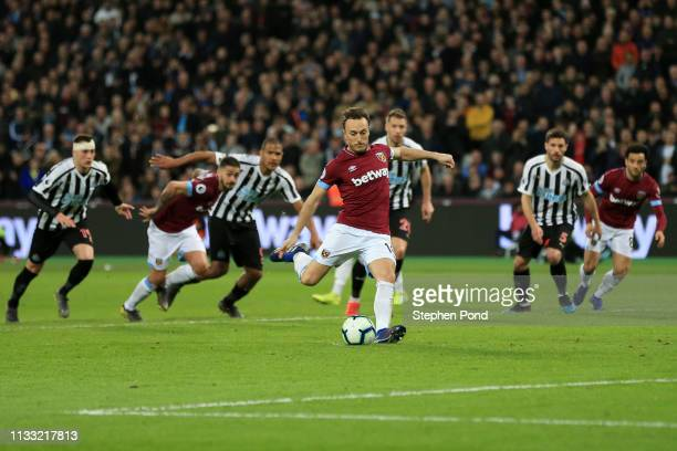 Mark Noble of West Ham United scores his team's second goal from the penalty spot during the Premier League match between West Ham United and...