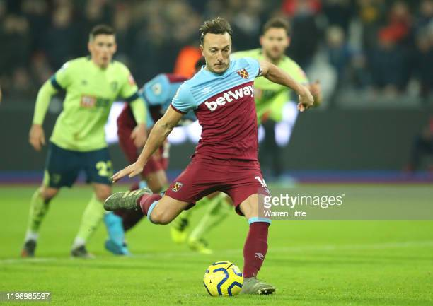 Mark Noble of West Ham United scores his team's third goal from the penalty spot during the Premier League match between West Ham United and AFC...