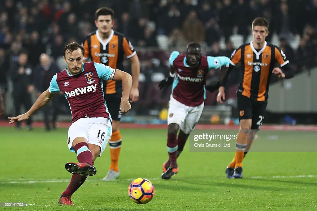 Mark Noble of West Ham United scores the first goal from a penalty kick to make the score 1-0 during the Premier League match between West Ham United and Hull City at London Stadium on December 17, 2016 in Stratford, England.
