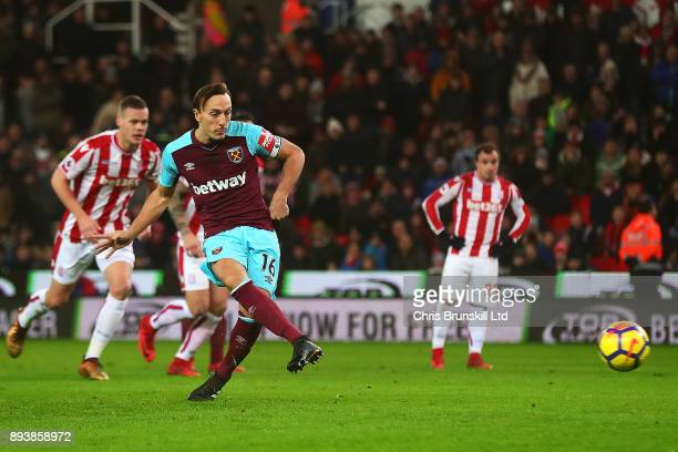 Mark Noble of West Ham United scores the opening goal from the penalty spot during the Premier League match between Stoke City and West Ham United at...