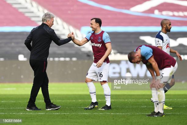 Mark Noble of West Ham United shakes hands with David Moyes , Manager of West Ham United following the Premier League match between West Ham United...