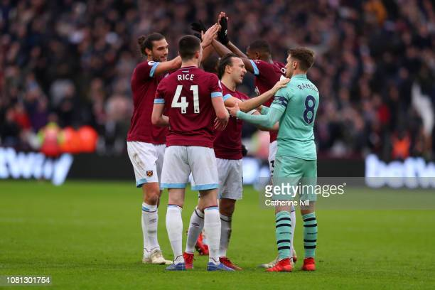 Mark Noble of West Ham United speaks to Aaron Ramsey of Arsenal after the Premier League match between West Ham United and Arsenal FC at London...