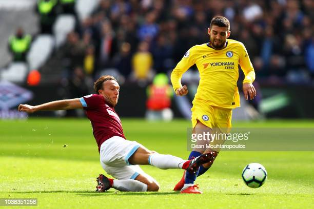 Mark Noble of West Ham United tackles Mateo Kovacic of Chelsea during the Premier League match between West Ham United and Chelsea FC at London...
