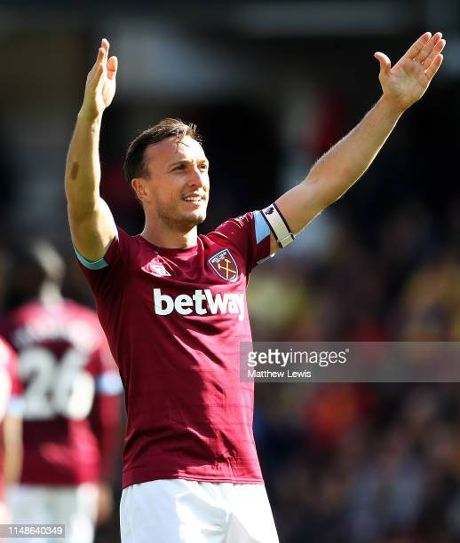 Mark Noble of West Ham United thanks the travelling supporters after scoring his second goal during the Premier League match between Watford FC and...