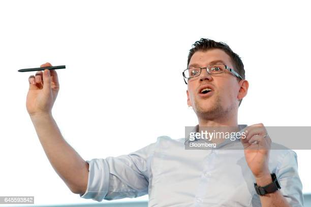Mark Notton executive at Samsung Electronics Co holds the company's S3 pen tablet accessory during the Samsung Press Conference ahead of the Mobile...