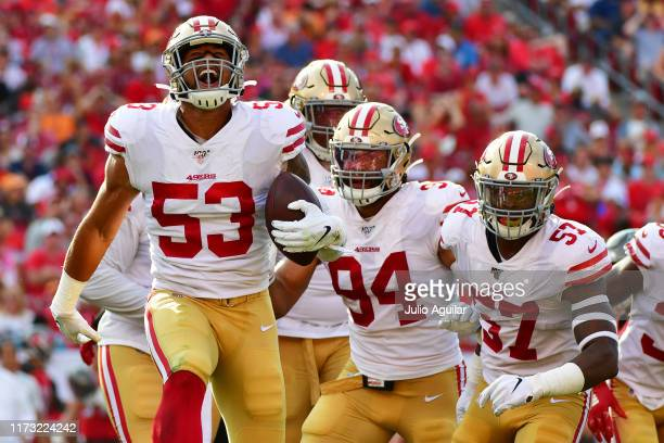 Mark Nzeocha of the San Francisco 49ers celebrates after intercepting Jameis Winston of the Tampa Bay Buccaneers in the second quarter of a football...