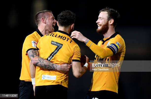 Mark O'Brien and Scot Bennett of Newport County celebrate with goal scorer Robbie Willmott of Newport County during the Sky Bet League Two match...