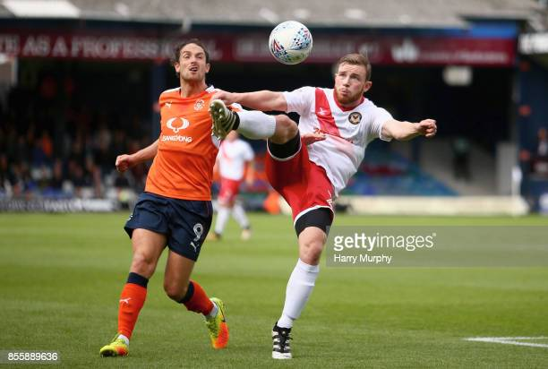 Mark O'Brien of Newport County and Danny Hylton of Luton Town battle for possession during the Sky Bet League Two match between Luton Town and...
