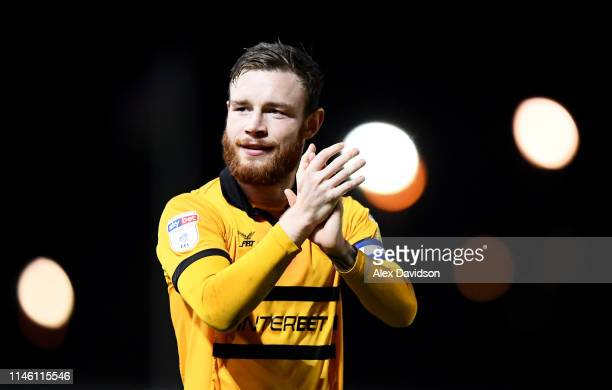 Mark O'Brien of Newport County applauds the crowd during the Sky Bet League Two match between Newport County and Oldham Athletic at Rodney Parade on...