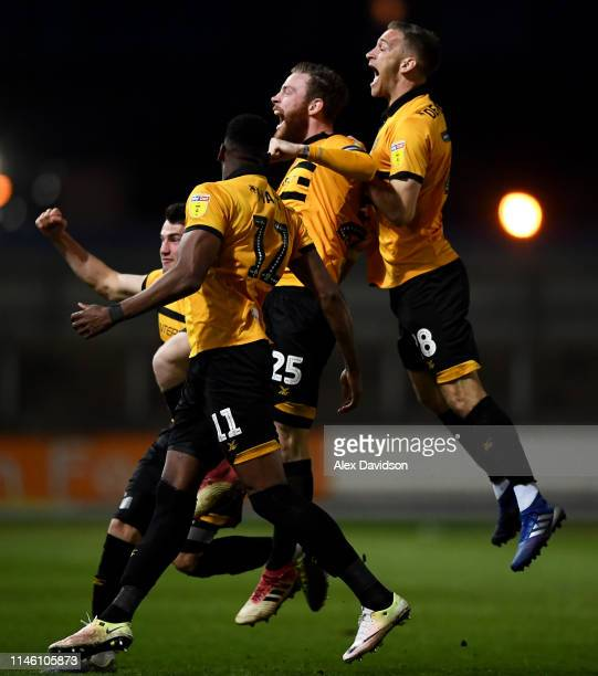 Mark O'Brien of Newport County celebrates scoring his sides first goal with Mickey Demetriou of Newport County and his teammates during the Sky Bet...