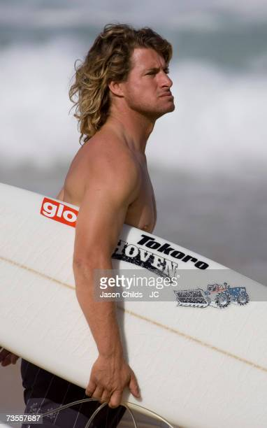 Mark Occilupo of Australia heads out into the surf during the RipCurl Pro WCT event at the Pipeline on the North Shore beaches of Oahu December 11...