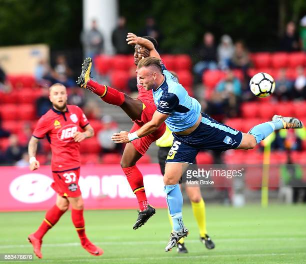 Mark Ochieng of Adelaide United and Jordy Buijs of Sydney FC during the round nine ALeague match between the Adelaide 36ers and the Sydney Kings at...