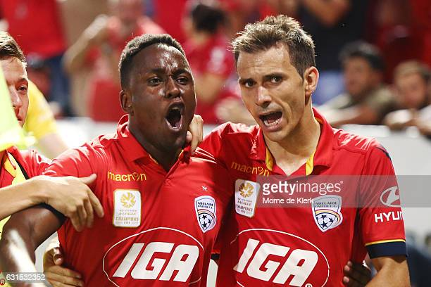 Mark Ochieng of Adelaide United celebrates with teammate Isaas after he scored the winning goal during the round 15 ALeague match between Adelaide...
