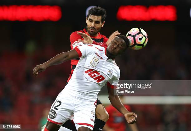 Mark Ochieng of Adelaide United competes for the ball against Dimas of the Wanderers during the round 22 ALeague match between the Western Sydney...
