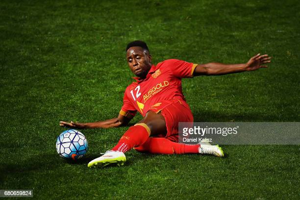 Mark Ochieng of United makes a sliding tackle during the AFC Champions League match between Adelaide United and Jiangsu Sainty at Hindmarsh Stadium...
