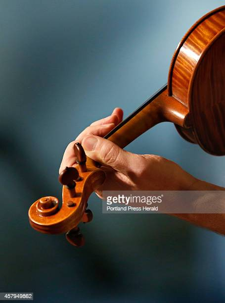 Mark O'Connor plays a violin made Jonathan Cooper while rehearsing for his performance with violinist and American fiddler Maggie Dixon and pianist...