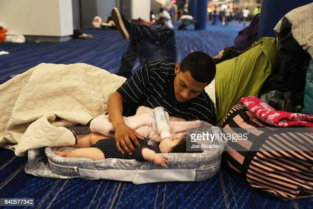 Mark Ocosta and his baby Aubrey Ocosta take shelter at the George R Brown Convention Center after flood waters from Hurricane Harvey inundated the...