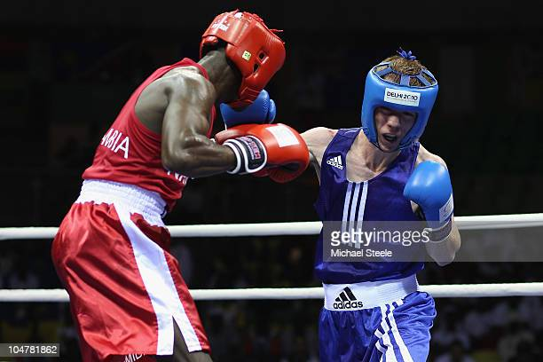 Mark O'Hara of Northern Ireland competes against Mikka Shonena of Namibia in the Light 60kg category at the Talkatora Indoor Stadium during day two...