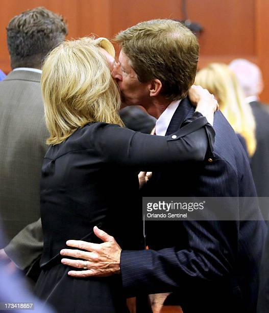 Mark O'Mara kisses his wife Jen after George Zimmerman was found not guilty on the 25th day of his trial at the Seminole County Criminal Justice...