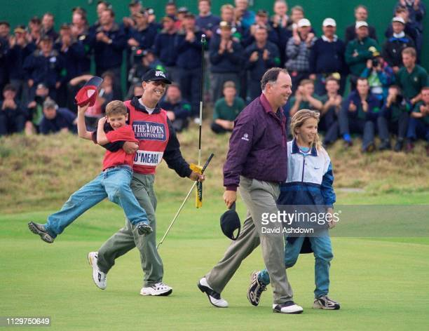 Mark O'Meara and caddie Jerry Higginbotham and son Shaun and daughter Michelle after winning the open after a play off with Brian Watts at the 127th...