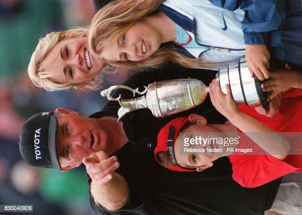 Mark O'Meara his wife Alicia son Shaun and daughter Michelle with the trophy after he had won the Open Championship at Royal Birkdale after a playoff...