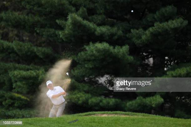 Mark O'Meara hits his third shot from a fairway bunker on the first hole during the second round of the Ally Challenge presented by McLaren at...