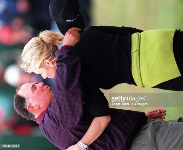 Mark O'Meara kisses his wife Alicia after he had won the Open Championship at Royal Birkdale today Photo Adam Butler/PA