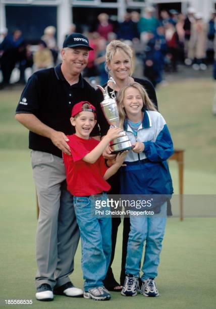 Mark O'Meara of the United States celebrates with his wife Alicia son Shaun and daughter Michelle as they holf the trophy after his victory at the...