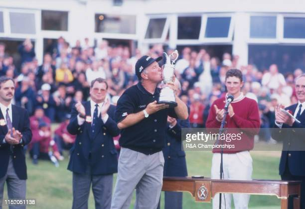 Mark O'Meara of the United States kisses the Claret Jug following his victory during The 127th Open Championship held at Royal Birkdale Golf Club...