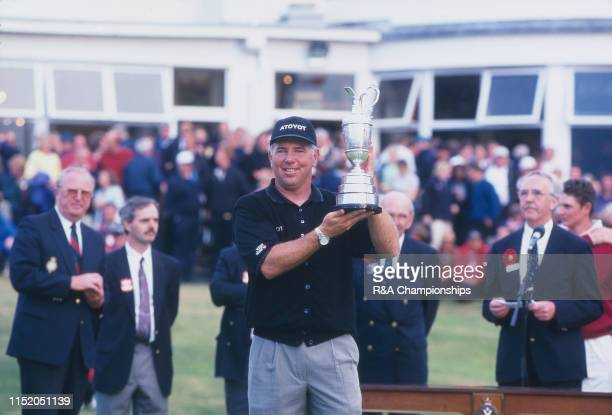 Mark O'Meara of the United States poses with the Claret Jug following his victory during The 127th Open Championship held at Royal Birkdale Golf Club...