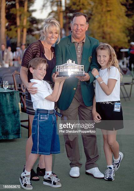 Mark O'Meara of the United States wearing the green jacket and holding the trophy with his wife Alicia daughter Michelle and son Shaun after winning...