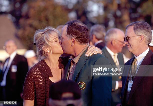 Mark O'Meara of the United States wearing the green jacket kisses his wife Alicia after winning the US Masters Golf Tournament held at the Augusta...
