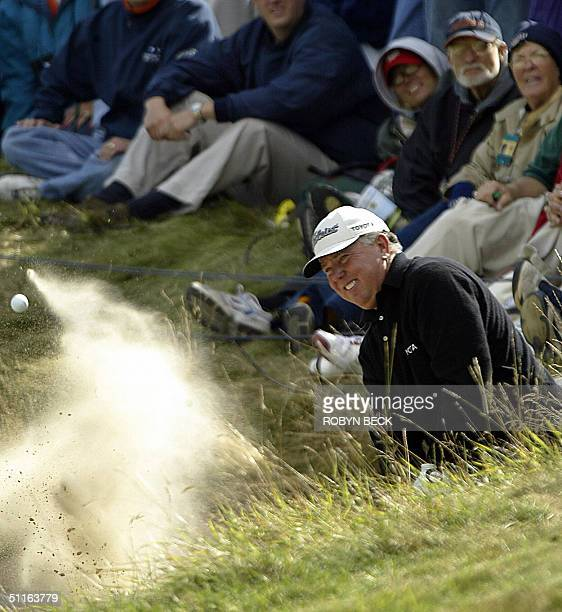 Mark O'Meara of the US hits out of a bunker on the 7th hole during the first round of the 86th PGA Championship at Whistling Straits in Kohler...