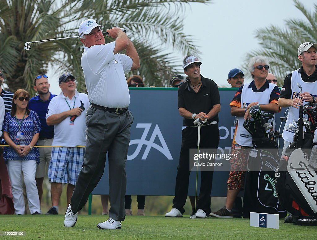 Mark O'Meara of the USA watched by Alice Cooper of the USA the legendary rock star on the second hole during the Challenge match at The Jebel Ali Hotel and Golf Resort as a preview for the 2013 Dubai Desert Classic on January 29, 2013 in Dubai, United Arab Emirates.