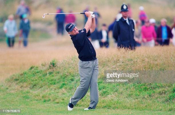 Mark O'Meara watched by a policeman during the 127th British Open Golf at Royal Birkdale GC in Southport 16th19th July 1998