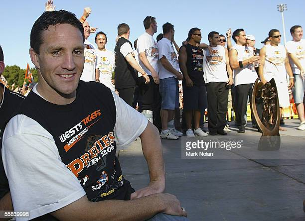 Mark O'Neill of the Tigers takes a break as his team mates celebrate during the Wests Tigers Grand Final celebrations at Leichhardt Oval on October 3...