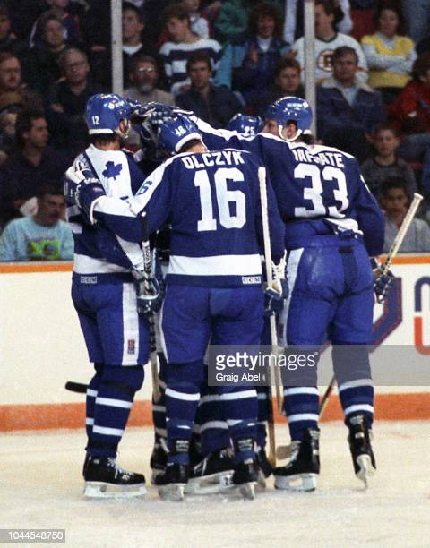 Mark Osborne Ed Olczyk and Al Iafrate of the Toronto Maple Leafs skate against the Winnipeg Jets during NHL game action on January 31 1990 at...
