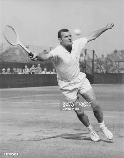Mark Otway of New Zealand reaches to make a forehand return to Billy Knight of Great Britainduring their Men's Singles Semi Final match at the Surrey...