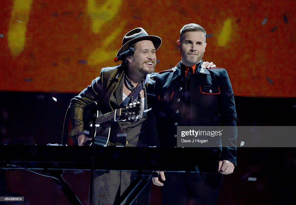 Mark Owen and Gary Barlow of Take That perform on stage at the BRIT Awards 2015 at The O2 Arena on February 25, 2015 in London, England.