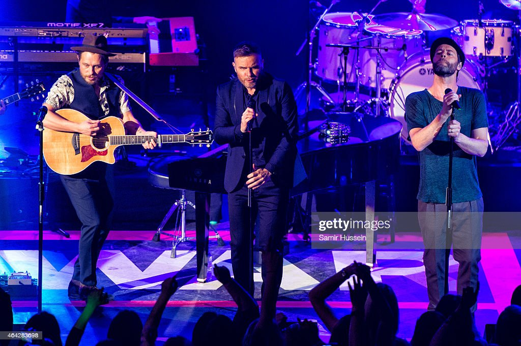 Mark Owen, Gary Barlow and Howard Donald of Take That perform on stage for the War Child BRITs show at O2 Shepherd's Bush Empire on February 23, 2015 in London, United Kingdom