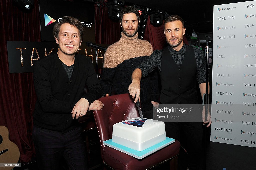 Mark Owen, Howard Donald and Gary Barlow of Take That cut a cake at an Exclusive Google Play gig to launch Take That's new album 'III' which will be available to stream exclusively on Google Play throughout December at Dover St Arts Club on December 1, 2014 in London, England.