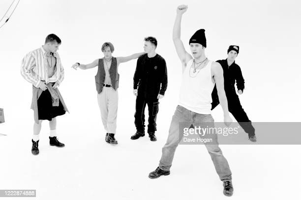 Mark Owen, Howard Donald, Gary Barlow, Robbie Williams and Jason Orange of Take That perform live in Tokyo, March 1993