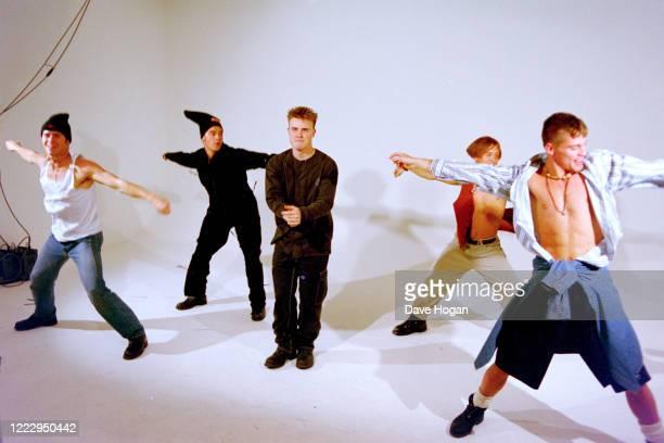 Mark Owen, Howard Donald, Gary Barlow, Robbie Williams and Jason Orange of Take That in Tokyo, March 1993